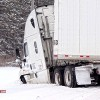 Semi slides into ditch by State Hospital