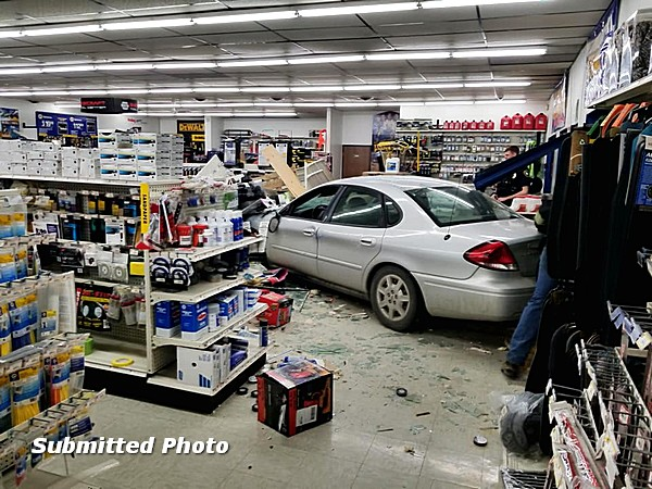 Man arrested, car strikes NAPA Auto Parts