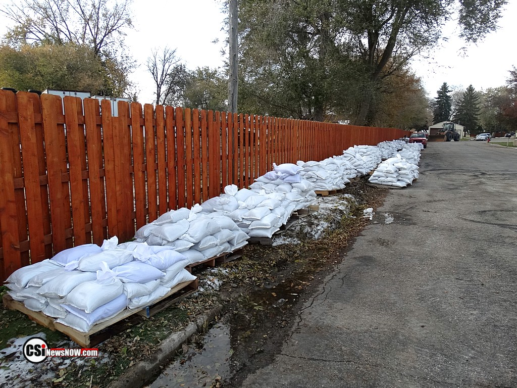 Sandbags staged along 2nd Ave SW townhouses