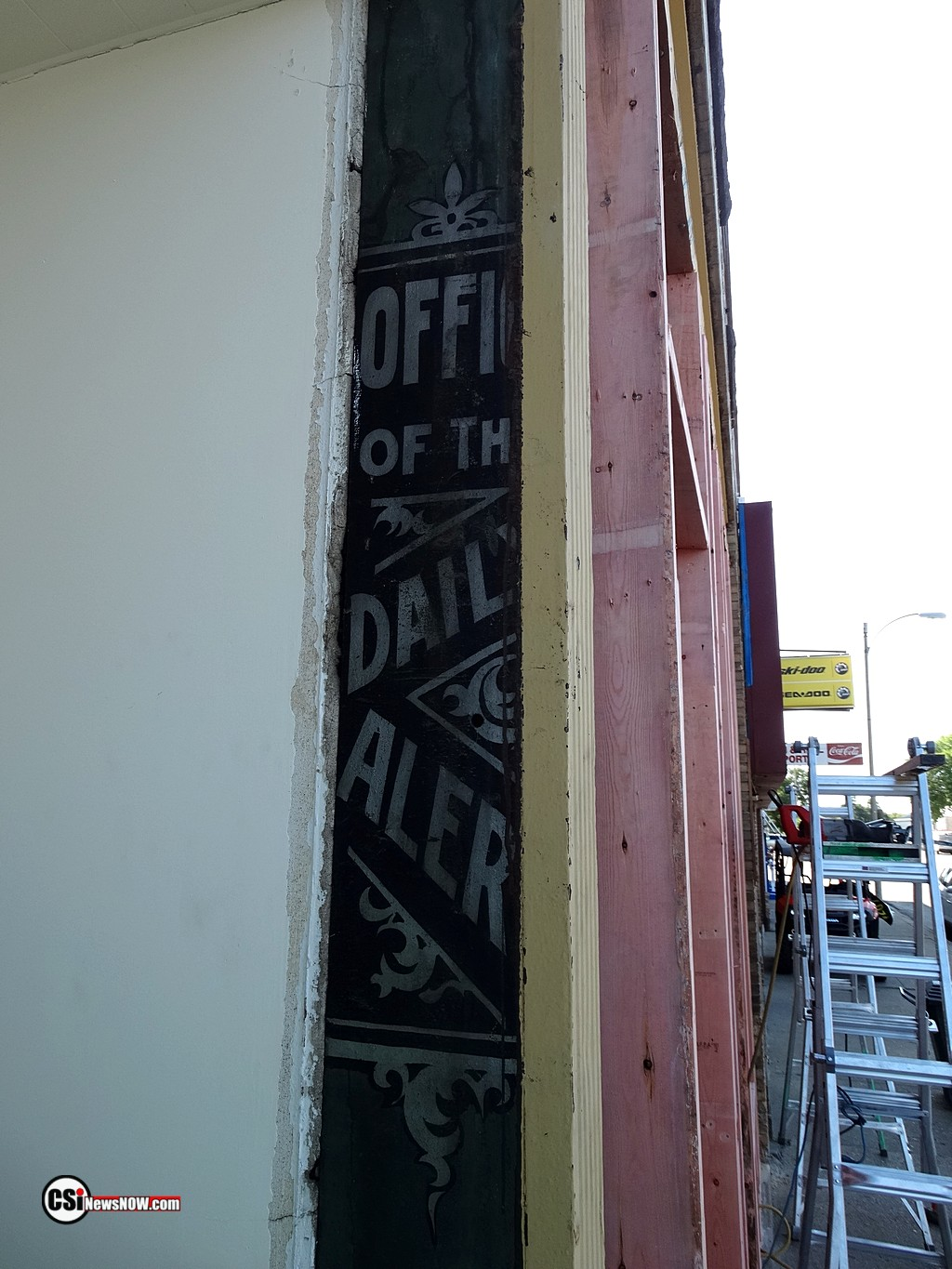 """""""Office of the Daily Alert"""" artwork on side of steel beam.      CSiphoto"""
